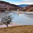 Stock Photo: Flooded church in toxic red lake. Water polluting by coppe