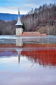 Abandoned church in the middle of a lake full with mining residu — Stock Photo
