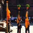 Stock Photo: Nepali soldiers standing with flags during festivity