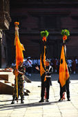 Nepali soldiers standing with flags during a festivity — Stock Photo