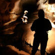 Cave passage with cave explorers — Stock Photo