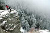 Trekkers on the summit at winter — Stock Photo
