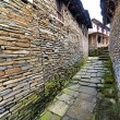 Narrow alley between stone houses — 图库照片