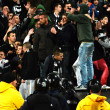 Постер, плакат: Hooligans during a football match