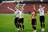 Soccer players celebrating a victory — Stock Photo