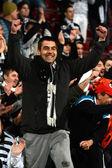 Soccer fan celebrating a victory — Stock Photo