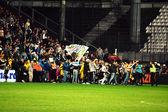 Soccer hooligans run on the soccer field — Stock Photo