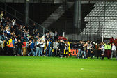 Football hooligans invasion on the soccer field — Stock Photo