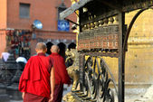 Buddhist monks spinning the prayer wheels — Stock Photo