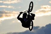 BMX rider bike jump in the air — Stock Photo