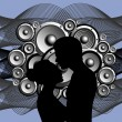 Royalty-Free Stock Векторное изображение: Silhouette of boy and girl on abstract music background