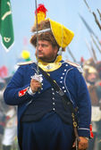 A soldier with a sward saluting at Borodino historical reenactment — Stock Photo