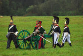 Soldiers loading a cannon at Borodino 2012 historical reenactment — Stock Photo
