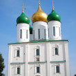 Old white orthodox church with green and golden cupolas and golden crosses. — Stock Photo