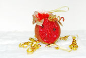 Red ball. Christmas decoration on white snow — Stock Photo