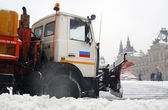 Snowstorm in Moscow. Special car is clearing the Red Square from snow. — Stock Photo
