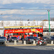 Red touristic bus drives in Moscow city center — Zdjęcie stockowe