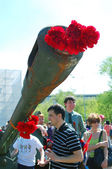Red carnations stick out of the barrel — Stock Photo