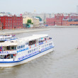 A cruise ship sails on the Moscow river. Moscow city center panorama in summer. — Stock Photo