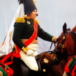 A reenactor dressed as Napoleonic war soldier rides a horse — Stock Photo