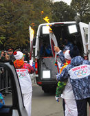 Torchbearers with torch flames — Stock Photo