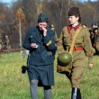 Two women soldiers - reenactors — Stock Photo