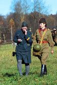 Two women soldiers - reenactors — Stock Photo