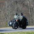 Stock Photo: Reenactors ride motorbike