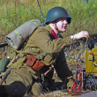 Stock Photo: Russisoldier-reenactor picks up phone