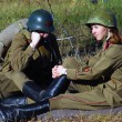Stock Photo: Mand womsoldiers-reenactors