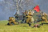 Vojáci se zbraněmi — Stock fotografie