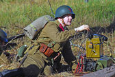 Russian soldier-reenactor picks up the phone — Stock Photo