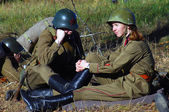 Man and woman soldiers-reenactors — Stock Photo