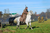 A man rides a white horse — Stock Photo