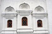 Three windows of an old church — 图库照片