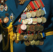 Military medals on the jacket of a war veteran. — Stock Photo