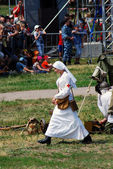 A nurse walks on the battle field. — Stock Photo