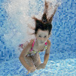 Underwater child jumps to swimming pool — Stock Photo