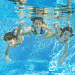 Stock Photo: Happy smiling family underwater in swimming pool