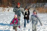 Happy family winter fun outdoors — Stock Photo