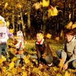 Family in autumn park — Stock Photo #16196299