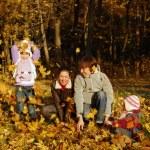 Family in autumn park — Stock Photo #16196459