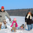Happy family winter fun outdoors - Stock Photo