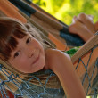 Little happy girl relaxing in hammock — Stock Photo
