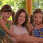 Happy mother and children having fun in hammock — Stock Photo #17615485