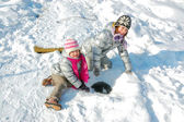 Kids having fun in winter outdoors — Stock Photo