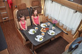 Happy smiling kids travel on camper — Stock Photo