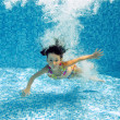 Happy underwater girl swims in pool — Stock Photo
