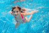 Happy underwater girl swims in pool — Stock Photo