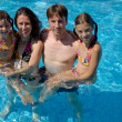Family in swimming pool, summer vacation — Stock Photo